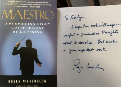 """Book cover of """"Maestro"""" by Roger Nierenberg, showing an orchestra conductor, next to a handwritten note to Emlyn Koster from the author"""