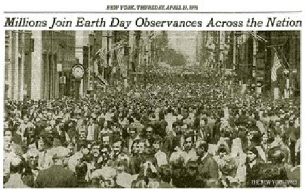 """Black and white image of the New York Times issue from April 23, 1970.  The cover features an image of a huge crowd that stretches across the entire page and the headline """"Millions Join Earth Day Observances Across the Nation."""""""